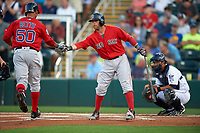 Boston Red Sox Dustin Pedroia (15) congratulates Mookie Betts (50) after hitting a home run during a Spring Training game against the Minnesota Twins on March 16, 2016 at Hammond Stadium in Fort Myers, Florida.  Minnesota defeated Boston 9-4.  (Mike Janes/Four Seam Images)