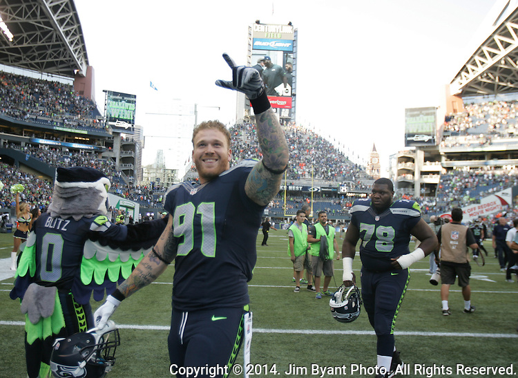 Seattle Seahawks defensive end Cassius Marsh departs the field after their victory over the Denver Broncos at CenturyLink Field in Seattle, Washington on September 21, 2014. The Seahawks won 26-20 in overtime.    ©2014. Jim Bryant Photo. All rights Reserved.