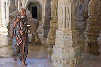 Jain pilgrim, with traditional mask removed, at The Ranakpur Jain Temple at Desuri Tehsil in Pali District, Rajasthan, India