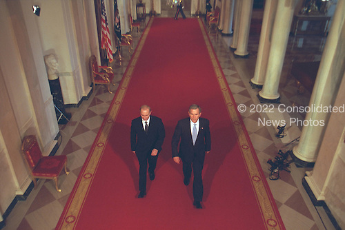 United States President George W. Bush and President Vladimir Putin of Russia walk through Cross Hall together to address the media at the White House in Washington, D.C. on Tuesday, November 13, 2001..Mandatory Credit: Paul Morse - White House via CNP.
