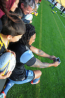 Ma'a Nonu takes an ussie with fans during the All Blacks rugby captain's run at Westpac Stadium, Wellington, New Zealand on Friday, 12 September 2014. Photo: Dave Lintott / lintottphoto.co.nz