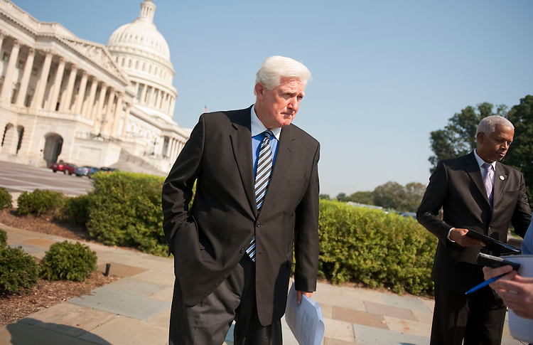 "UNITED STATES - SEPTEMBER 14:  Reps. Jim Moran, D-Va., left, and Hank Johnson, D-Ga., conduct a news conference at the House Triangle to introduce the ""Full Faith and Credit Act of 2011,"" which would eliminate the federal debt ceiling, and ensure that the U.S. would not default on it's financial obligations. (Photo By Tom Williams/Roll Call)"