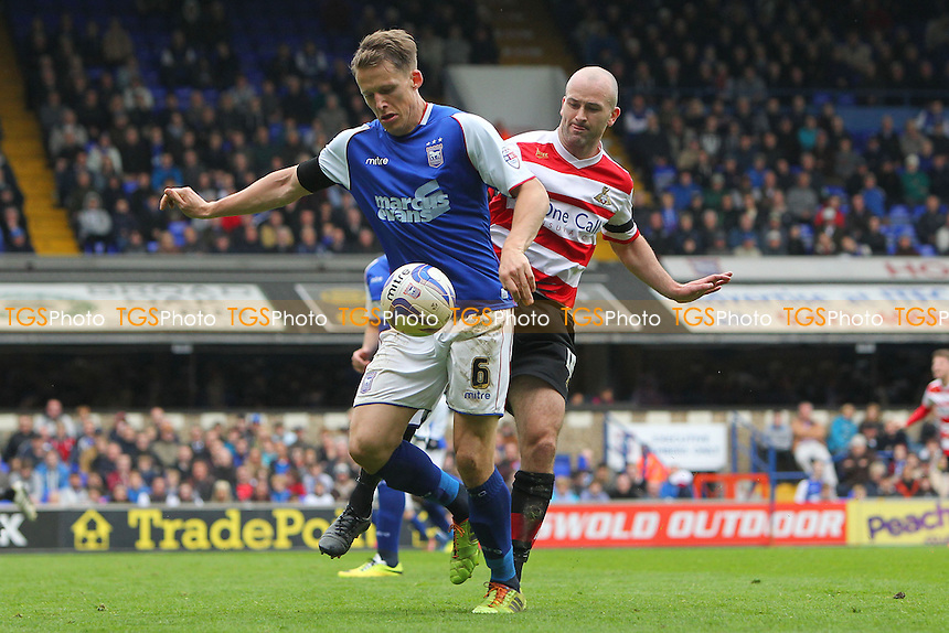 Christophe Berra of Ipswich Town shields the ball from Paul Keegan of Doncaster Rovers - Ipswich Town vs Doncaster Rovers - Sky Bet Championship Football at Portman Road, Ipswich, Suffolk - 12/04/14 - MANDATORY CREDIT: Gavin Ellis/TGSPHOTO - Self billing applies where appropriate - 0845 094 6026 - contact@tgsphoto.co.uk - NO UNPAID USE
