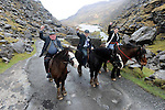 22-2-2011: TRUE GRIT... South Kerry Independent candidate Michael Healy-Rae canvassing the traditional way on horseback with his father Jackie and daughter Rosie in the Gap of Dunloe, Killarney which is normally restricted to horse traffic. 80 years old Jackie joined Michael to canvas some of the most difficult terrain in the county in a bid to win the last votes on Tuesday. Deputy Healy-Rae is fighting an uphill battle according to the polls to retain his father's seat.<br /> Picture by Don MacMonagle