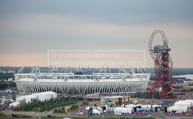 27/07/2012. LONDON, UK. The Olympic Stadium and the ArcelorMittal Orbit tower are seen in the Olympic Park ahead of the 2012 Summer Olympic opening ceremony in London today (27/07/12). Constituting the third time the Olympic Games have been held in Great Britain, the 2012 Olympic Games, also known as the Games of the XXX Olympiad opened this evening with a show, put together by 'Slum Dog Millionaire' director Danny Boyle, entitled 'The Isles of Wonder. Photo credit: Matt Cetti-Roberts