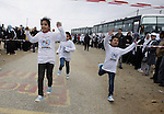 Participants warm up before competing in the UN-sponsored Gaza marathon in Rafah town, in the southern Gaza Strip on March 1, 2012. Thousands of runners braved temperatures hovering just above zero degrees centigrade to take part in the impoverished Palestinian territory's second-ever marathon. Photo by Abed Rahim Khatib