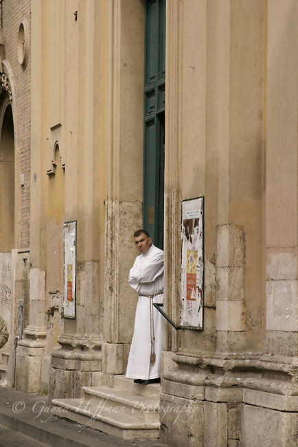 Priest on steps outside church.Rome,Italy