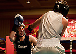 February 3, 2012:   Nevada boxer Taylor Yancey, left, fights Air Force Academy boxer Andrew Munoz in the 137 pound weight class match held at the Eldorado Convention Center on Friday night in Reno, Nevada.  Yancey won the bout.