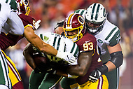 Landover, MD - August 16, 2018: New York Jets running back Thomas Rawls (30) is tackled for a loss by Washington Redskins defensive end Jonathan Allen (93)  during preseason game between the New York Jets and Washington Redskins at FedEx Field in Landover, MD. (Photo by Phillip Peters/Media Images International)