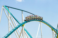 Photography of the Fury 325 , a steel roller coaster at the Carowinds amusement park located in Charlotte, North Carolina and Fort Mill, South Carolina. Carowinds Fury 325 reaches a maximum height of 325 feet (99 m) making it the tallest and fastest Giga Coaster in the world and the 5th tallest overall.  Coaster riders reach speeds up to 95 miles per hour (153 km/h).<br /> <br /> Charlotte Photographer - PatrickSchneiderPhoto.com