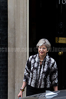 Theresa May MP (Prime Minister, First Lord of the Treasury, Minister for the Civil Service).<br /> <br /> London, 12/06/2017. Today, Theresa May's reshuffled Cabinet met at 10 Downing Street after the General Election of the 8 June 2017. Philip Hammond MP - not present in the photos - was confirmed as Chancellor of the Exchequer. <br /> After 5 years of the Coalition Government (Conservatives &amp; Liberal Democrats) led by the Conservative Party leader David Cameron, and one year of David Cameron's Government (Who resigned after the Brexit victory at the EU Referendum held in 2016), British people voted in the following way: the Conservative Party gained 318 seats (42.4% - 13,667,213 votes &ndash; 12 seats less than 2015), Labour Party 262 seats (40,0% - 12,874,985 votes &ndash; 30 seats more then 2015); Scottish National Party, SNP 35 seats (3,0% - 977,569 votes &ndash; 21 seats less than 2015); Liberal Democrats 12 seats (7,4% - 2,371,772 votes &ndash; 4 seats more than 2015); Democratic Unionist Party 10 seats (0,9% - 292,316 votes &ndash; 2 seats more than 2015); Sinn Fein 7 seats (0,8% - 238,915 votes &ndash; 3 seats more than 2015); Plaid Cymru 4 seats (0,5% - 164,466 votes &ndash; 1 seat more than 2015); Green Party 1 seat (1,6% - 525,371votes &ndash; Same seat of 2015); UKIP 0 seat (1.8% - 593,852 votes); others 1 seat. <br /> The definitive turn out of the election was 68.7%, 2% higher than the 2015.<br /> <br /> For more info about the election result click here: http://bbc.in/2qVyNRd &amp; http://bit.ly/2s9ob51<br /> <br /> For more info about the Cabinet Ministers click here: https://goo.gl/wmRYRd