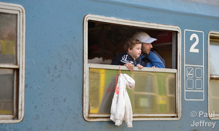 People look out the window of a train as it arrives in the Hungarian town of Hegyeshalom. Migrants and refugees aboard the special train walk from here across the border into Austria. Hundreds of thousands of refugees and migrants flowed through Hungary in 2015, on their way to western Europe from Syria, Iraq and other countries.