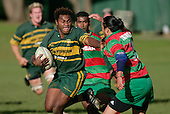 S. Lutumailagi tries to fend off T. Kiel. Counties Manukau Premier Club Rugby, Pukekohe v Waiuku  played at the Colin Lawrie field, on the 3rd of 2006.Pukekohe won 36 - 14