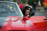Imperial Court Chauffeur Emma Walden applies makeup before driving the parade route through Anchorage in a 1971 Chevy Chevelle during Alaska PrideFest's 2015 Equality Parade.