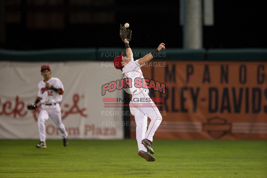 Orem Owlz second baseman Justin Jones (33) leaps to catch a pop up during a Pioneer League game against the Ogden Raptors at Home of the OWLZ on August 24, 2018 in Orem, Utah. The Ogden Raptors defeated the Orem Owlz by a score of 13-5. (Zachary Lucy/Four Seam Images)