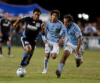 Quincy Amarikwa (left) drives in ahead of Mehdl Ballouchy (8) against Nick LaBrocca (22). San Jose Earthquakes tied the Colorado Rapids 1-1 at Buck Shaw Stadium in Santa Clara, California on September 18, 2009.