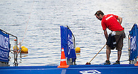 12 JUL 2014 - HAMBURG, GER - A member of the race team sweeps the swim exit ramp before the start of the  elite women's 2014 ITU World Triathlon Series round in the Altstadt Quarter in Hamburg, Germany (PHOTO COPYRIGHT © 2014 NIGEL FARROW, ALL RIGHTS RESERVED)