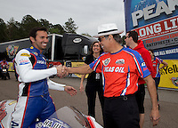 Mar. 17, 2013; Gainesville, FL, USA; NHRA pro stock motorcycle rider Hector Arana Jr celebrates with his father Hector Arana Sr after winning the Gatornationals at Auto-Plus Raceway at Gainesville. Mandatory Credit: Mark J. Rebilas-