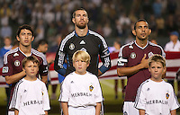 CARSON, CA – September 9, 2011: Colorado Rapid players Kosuke Kimura (27), Matt Pickens (18) and Pablo Mastroeni (25) before the match between LA Galaxy and Colorado Rapids at the Home Depot Center in Carson, California. Final score LA Galaxy 1, Colorado Rapids 0.
