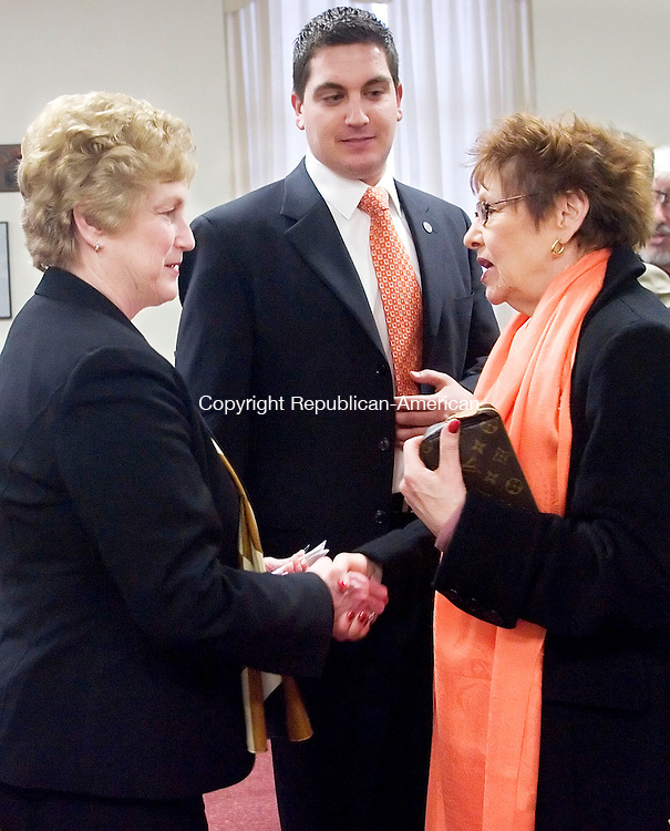 TORRINGTON, CT- 19 MARCH 2008- 031908JT05-<br /> Gov. M. Jodi Rell shakes hands with Torrington City Council member Marie Soliani as Mayor Ryan Bingham looks on after Rell spoke at Torrington City Hall on Wednesday to announce that $504,875 for Torrington's downtown redevelopment is expected to be approved by the State Bond Commission during their meeting on March 28. <br /> Josalee Thrift / Republican-American