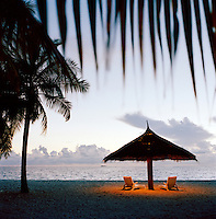 Beach and sun-loungers at dusk, Maldives, Indian Ocean