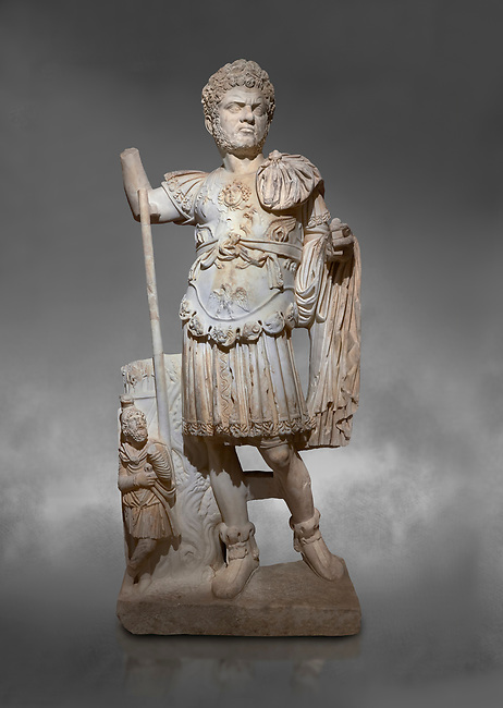 Roman statue of Emperor Caracalla. Marble. Perge. 2nd century AD. Inv no  2014/194. Antalya Archaeology Museum; Turkey.  Against a grey background<br /> <br /> Caracalla Roman emperor from 198 to 217 AD. He was a member of the Severan Dynasty, the elder son of Septimius Severus and Julia Domna. Co-ruler with his father from 198, he continued to rule with his brother Geta, emperor from 209, after their father's death in 211. He had his brother murdered later that year, and reigned afterwards as sole ruler of the Roman Empire.
