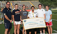 Philadelphia general manager, Louise Waxler, presents a check to the Make-A-Wish Foundation prior to the Philadelphia game against Sky Blue.  Philadelphia Independence defeated Sky Blue, 2-1, at John Farrell Stadium in West Chester, PA.