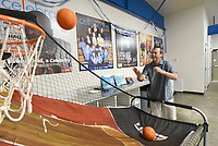 NWA Democrat-Gazette/FLIP PUTTHOFF <br /> Matt Taliaferro, CEO of the Boys and Girls Club of Benton County, shows Wednesday July 3 2019 a basketball game in the game room of the club's new teen center in Rogers.
