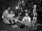 Wilkinsburg PA:  Sarah, Brady Jr and Helen Stewart checking out the toys under the Christmas Tree - 1921.