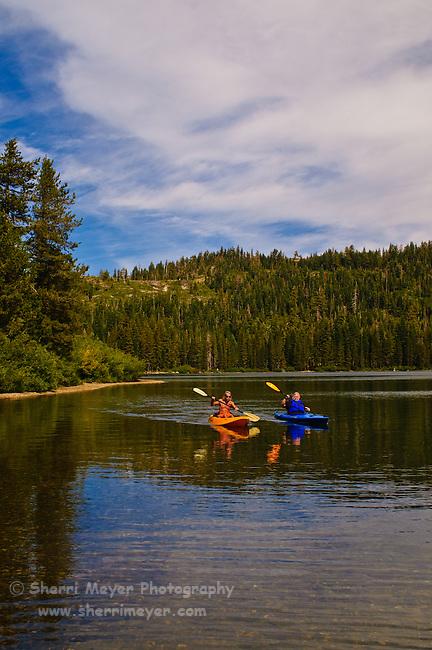Two men kayaking on Gold Lake, Lakes Basin, Northern California.