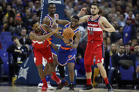 17th January 2019, The O2 Arena, London, England; NBA London Game, Washington Wizards versus New York Knicks; Emmanuel Mudiay of the New York Knicks competes with Trevor Ariza of the Washington Wizards for the loose ball