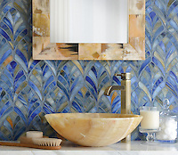 Margot, a handmade mosaic, is shown in Blue Onyx jewel glass and was designed by New Ravenna.