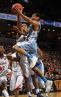 North Carolina guard Marcus Paige (5) shoots next to Virginia guard Malcolm Brogdon (15) during the first half of an NCAA basketball game Monday Jan. 20, 2014 in Charlottesville, VA. ( Photo/Andrew Shurtleff)