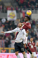 12th January 2020; Olympic Grande Torino Stadium, Turin, Piedmont, Italy; Serie A Football, Torino versus Bologna; Soualiho Meite of Torino FC wins a header over Roberto Soriano of Bologna FC - Editorial Use