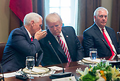 United States Vice President Mike Pence whispers to US President Donald J. Trump during a meeting with Amir Sabah al-Ahmed al-Jaber al-Sabah of Kuwait(unseen) at The White House in Washington, DC, September 7, 2017. <br /> Credit: Chris Kleponis / Pool via CNP