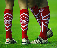 PICTURE BY VAUGHN RIDLEY/SWPIX.COM - Rugby League - Super League - Wigan Warriors v Warrington Wolves - JJB Stadium, Wigan, England - 23/03/12 - Sport Relief Socks.