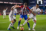 Filipe Luis of Atletico de Madrid competes for the ball with Daniel Carvajal Ramos (l) and Lucas Vazquez of Real Madrid during their La Liga match between Atletico de Madrid and Real Madrid at the Vicente Calderón Stadium on 19 November 2016 in Madrid, Spain. Photo by Diego Gonzalez Souto / Power Sport Images