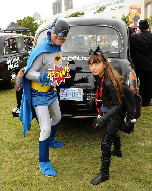 Batman and Cat Girl Fan at Comic-Con 2014 in San Diego, Ca. July 26, 2014.
