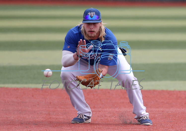 Western Nevada College's Rayne Raven picks up a ground ball to third for an out against Mt. Hood at John L. Harvey Field in Carson City, Nev., on Friday, March 14, 2014. <br /> Photo by Cathleen Allison/Nevada Photo Source