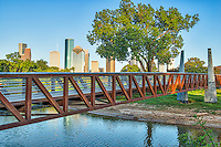 Houston Skyline from Park -  This is a pedestrian bridge over the Buffalo Bayou near downtown at Houston park with many of  the city's skyscrapers in the view.  You can see the iconic Chase Towers, the Heritage Plaza, and many other of the tall buildings in downtown area.