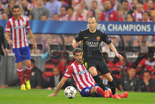 09.05.2014 Madrid, SPAIN . UEFA Champions League Quarter-finals 2nd leg, match played between Atletico de Madrid versus F.C. Barcelona at Vicente Calderon stadium.  Raul Garcia (Atl. Madrid) Andreas Iniesta (FC Barcelona)