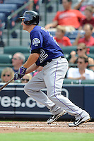 Colorado Rockies first baseman Jordan Pacheco #22  swings at a  pitch during a game against the Atlanta Braves at Turner Field on September 3, 2012 in Atlanta, Georgia. The Braves  defeated the Rockies 6-1. (Tony Farlow/Four Seam Images).