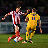 Lincoln City's Alex Woodyard vies for possession with Chester's Blaine Hudson<br /> <br /> Photographer Chris Vaughan/CameraSport<br /> <br /> Vanarama National League - Lincoln City v Chester - Tuesday 11th April 2017 - Sincil Bank - Lincoln<br /> <br /> World Copyright &copy; 2017 CameraSport. All rights reserved. 43 Linden Ave. Countesthorpe. Leicester. England. LE8 5PG - Tel: +44 (0) 116 277 4147 - admin@camerasport.com - www.camerasport.com