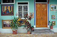 Paintings for sale outside a restored house in the Las Penas historic district on Cerro Santa Ana, Guayaquil, Ecuador