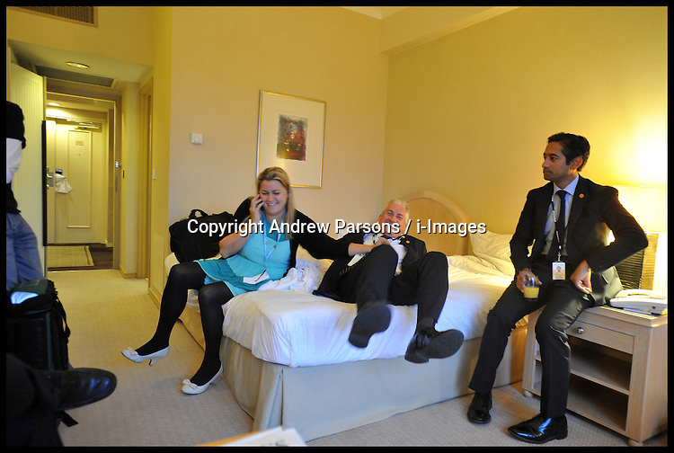 Members of downing street staff in the main conference hotel room during the Conservative party conference, International Convention Centre, October 10, 2012, Birmingham, England. Photo by Andrew Parsons / i-Images..