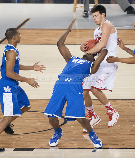 Wisconsin Badgers forward Duje Dukan (13) grabs the rebound from Kentucky Wildcats forward Alex Poythress (22) during the NCAA Final Four vs. Wisconsin at the AT&T in Arlington, Tx., on Saturday, April 5, 2014. Photo by Eleanor Hasken | Staff