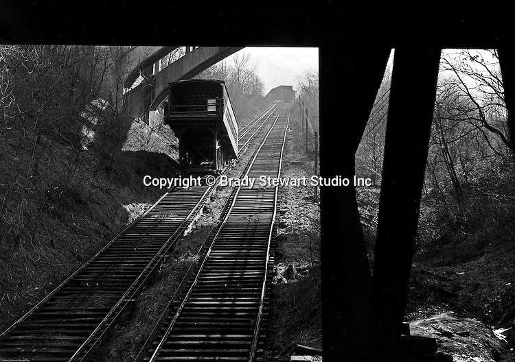 Pittsburgh PA:  View of the Castle Shannon Incline from Carson Street.  It was originally built in 1890 as part of the Pittsburgh and Castle Shannon Railroad as a means of transporting people over Mt. Washington.  Its large cars were able to carry both passengers and automobiles. Originally steam powered, it was converted to electrical operation in 1918 by the Otis Elevator Company..The incline was closed 21 June 1964.[