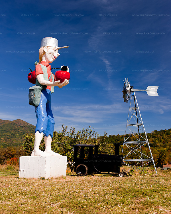 A large resin statue of Johnny Appleseed, at the top of the hill near the picnic area at Johnson Orchards and Peaks of Otter Winery.