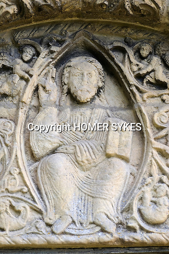 St Nicholas church Barfreston or spelt Barfestone Kent. Norman church exterior carvings date from the late 12th century. Figure of Christ with bible above he door to enter the church.