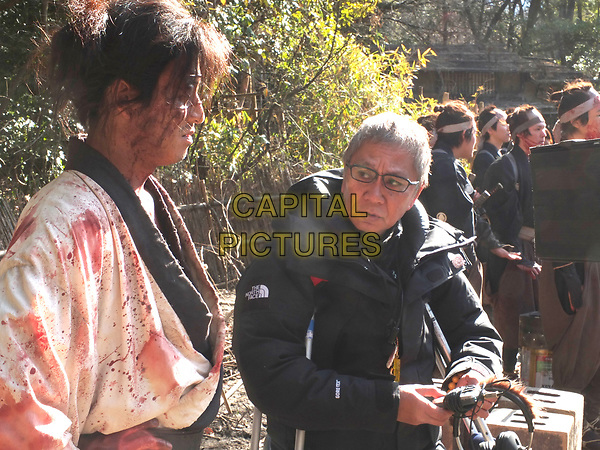 Blade of the Immortal (2017) <br /> (Mugen no junin)<br /> Director Takashi Miike on the set of <br /> *Filmstill - Editorial Use Only*<br /> CAP/KFS<br /> Image supplied by Capital Pictures